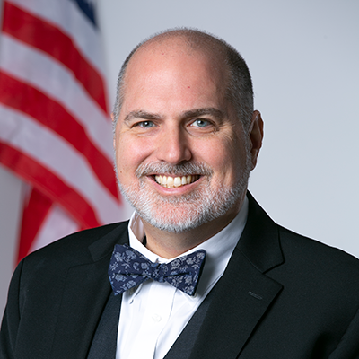 Headshot of Executive Director C. Joshua Villines.